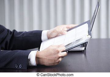 businessman reading a document - Close up hand of...