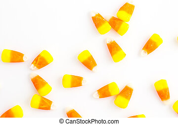 Candy corn candies on a white background.