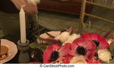 Florist making bouquet for holiday table, close-up