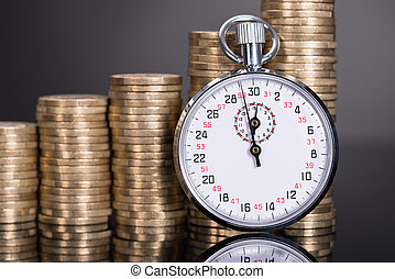 Time and money growth over black background