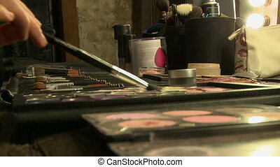 Close-up of makeup artist using cosmetics - View of makeup...
