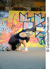 breakdancing - Young woman breakdancing