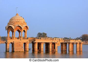 Gadi Sagar temple at Gadisar lake, Jaisalmer, India - Gadi...