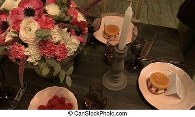 View of experienced florist decorates table, close-up