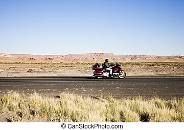 Biker on highway - Route 89 in Arizona, USA near Page