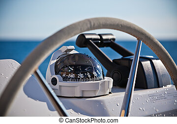 Sailing yacht control wheel and implement. Horizontal shot...