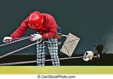 Industrial worker hanging on a rope from a bridge.Reflection...