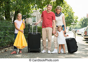 Happy Young Family Traveling Going On Vacation. Outdoors...