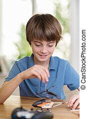 Little boy dismantling an electronic device - Intelligent...
