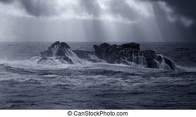 Sea Cliff - Large boulder off the Portuguese coast in stormy...