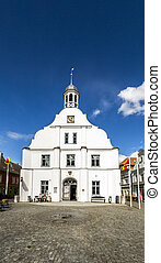 famous historic town hall facade in Wolgast under blue sky