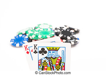 Cards with poker chips isolated on white background