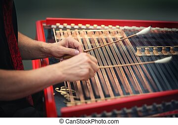 play the cimbalom - Playing the dulcimer folk musical...