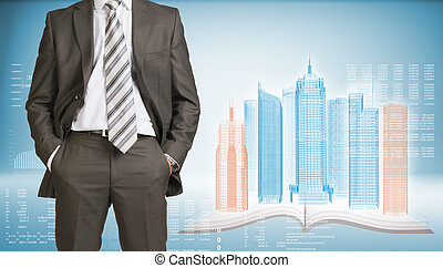Businessman and wire-frame buildings on open book -...