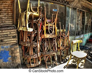 Old piled chairs in a street in Cairo Egypt