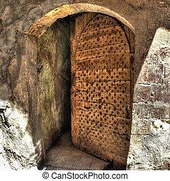Old half-open door - Detail of old half-open door in the...