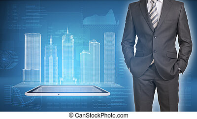 Businessman and wire-frame buildings on screen tablet pc -...