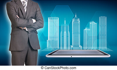 Businessman and wire-frame buildings on screen tablet -...