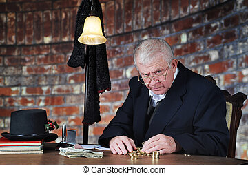 Grumpy Money-Counter - A grumpy old man scowling at the...