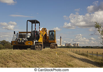 ready for monday - two mechanical diggers parked on a river...