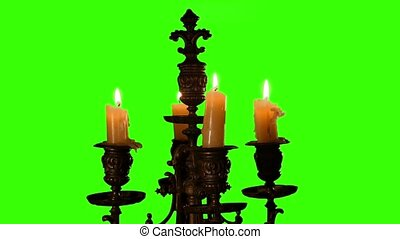 Candle in vintage candlestick on green screen - Candles are...