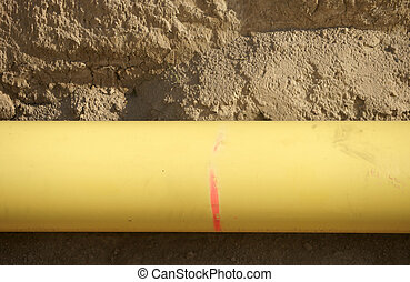 Gas pipe - The closeup of a yellow-marked gas line in the...