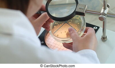 male scientist working in with microscope. clinician...