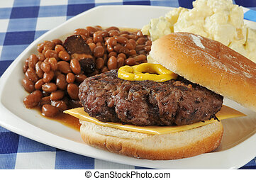 Home cooked hamburger - A home grilled hamburger with baked...