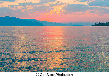 sunrise over the sea pink colors