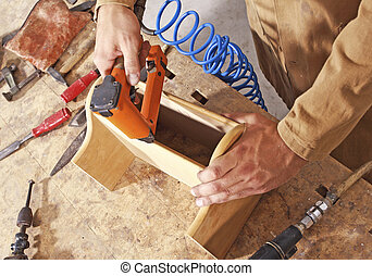 craft work - detail of caucasian carpenter at work with tool