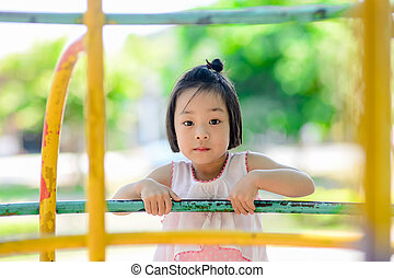 Asian little kid playing in the amusement park