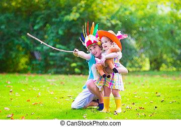 Kids playing cowboy - Two happy kids, laughing boy dressed...