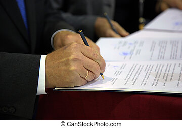 signing the document - human Hand signing the document