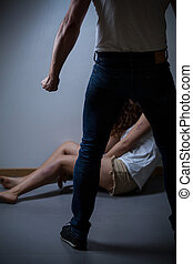 Violence in a relationship - Aggressive men standing over...