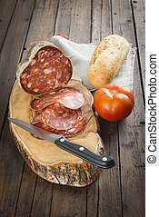 Morcon, a Spanish sausage with bread and tomato - Morcon, a...