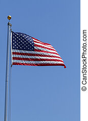 American Flag Flapping In The Wind On A Clear Day