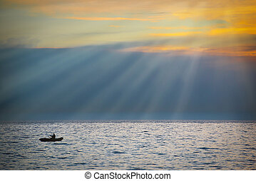 Sea landscape with boat against dramatic sunset