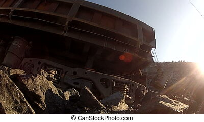 The train cars loaded with ore in the quarry.