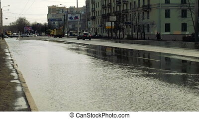 Breakthrough of water pipe in the city. The flood.