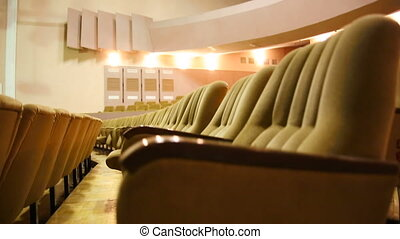 Empty cinema room with balcony.