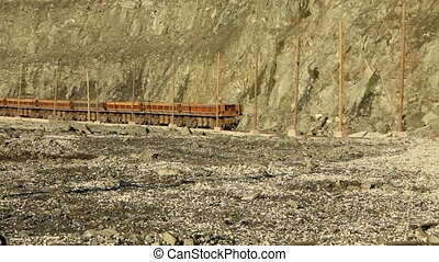 The train cars loaded with ore in the quarry