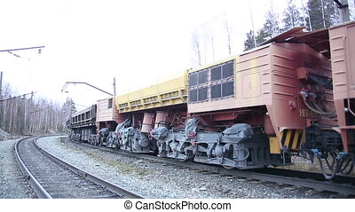 A freight train. The cars. The wheels.