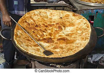 big pankake chapatti bread in Mumbai Bombay market - big...