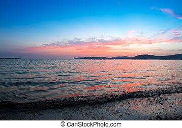pink sunset in Alghero shoreline