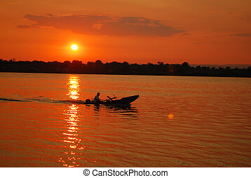 Boat At Sunset - a small fishing boat at sunset on danube...