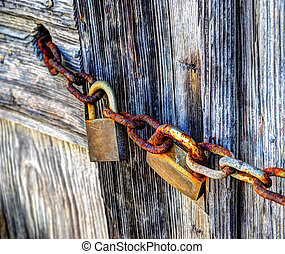 padlocks and chain - padlocks and rusty chain in hdr tone