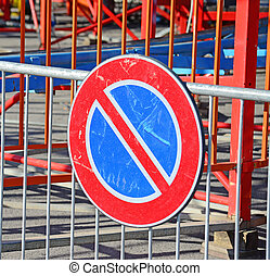 no parking - steel barrier and no parking sign
