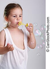 Girl with bubble blower - Small child playing with a bubble...