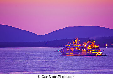 ferry boat in Alghero coastline at dusk