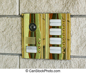 entry phone - golden entry phone in a brick wall